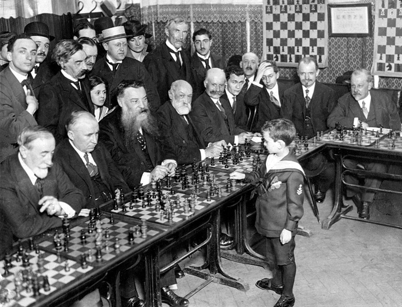 "Samuel ""Sammy"" Herman Reshevsky, age 8, defeating several chess masters at once in France."
