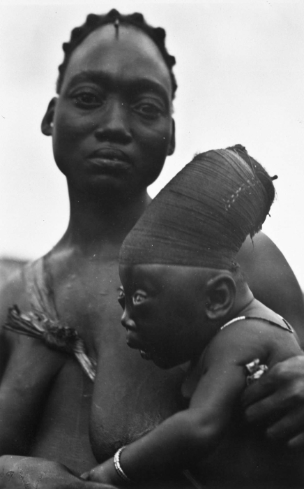 Taken in 1930. An elongated head, a sign of beauty, of a Mangbetu child. (1930)